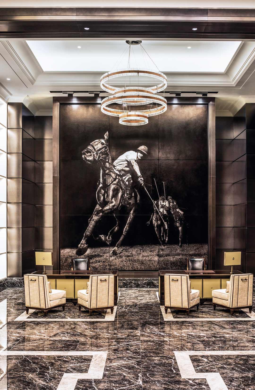 A polo scene dominates the lobby of the St. Regis Kuala Lumpur.