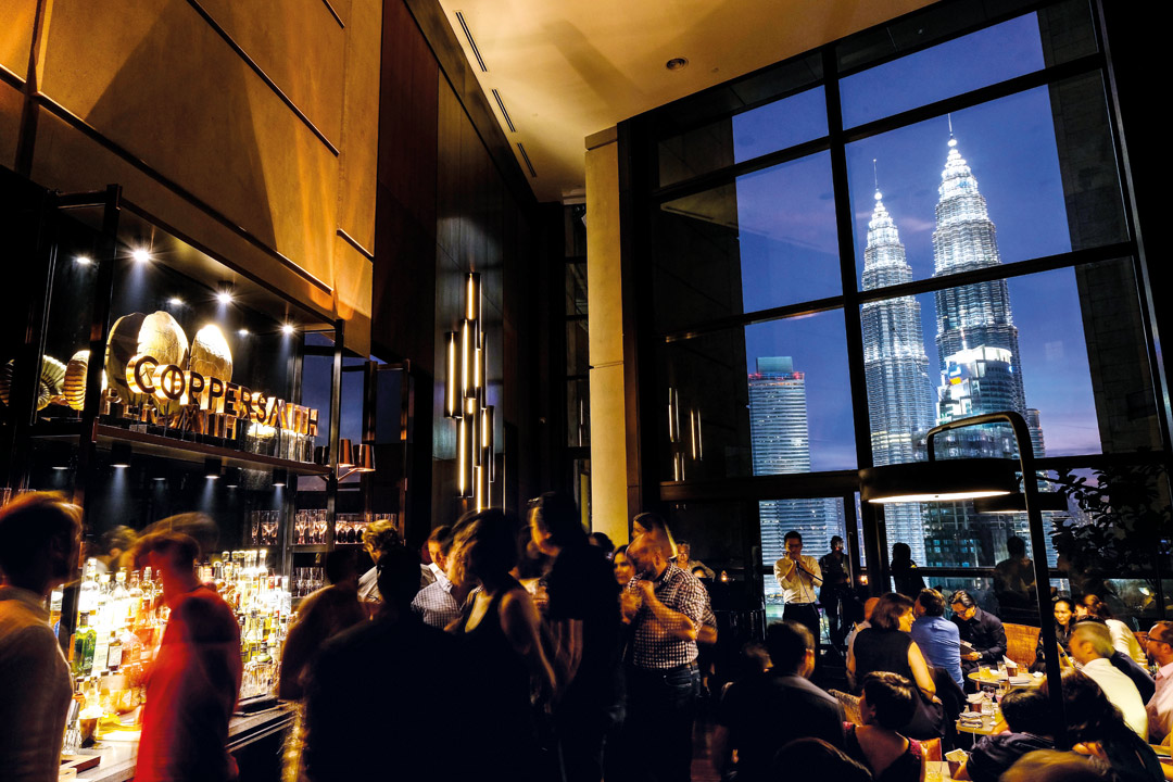 Cocktails at Coppersmith are served with views of the Petronas Twin Towers.