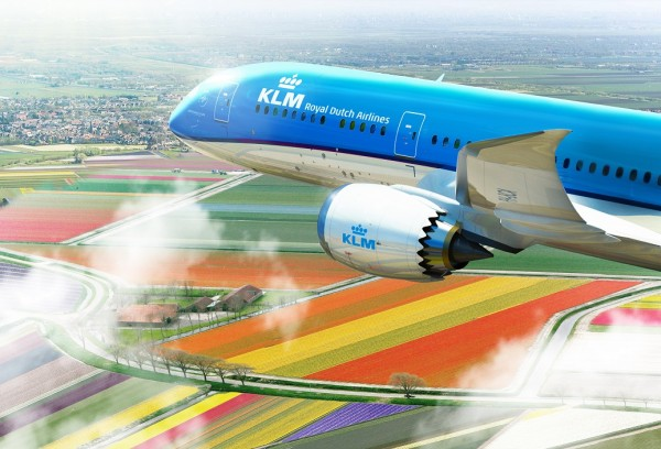 KLM's new Boeing 787-9 Dreamliner shown flying over tulip fields.
