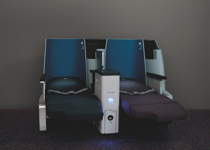 Privacy screens between seats allow additional personal space.