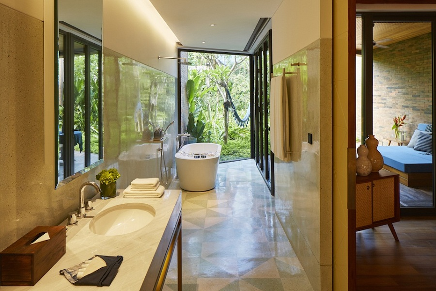 Standalone bathtubs and clean lines in a Pool Suite bathroom.