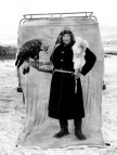 Another veteran falconer in a fox-skin coat posing with his eagle.
