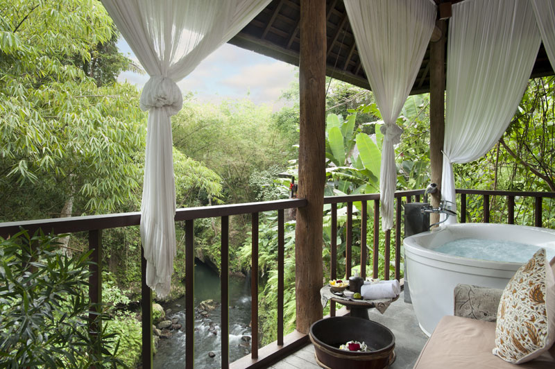 Komaneka at Bisma's spa villas overlook the verdant valley.