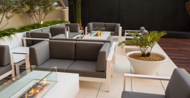 The new Star Alliance lounge at LAX has an outdoor terrace complete with fire pits, waterfalls, and panoramic views.