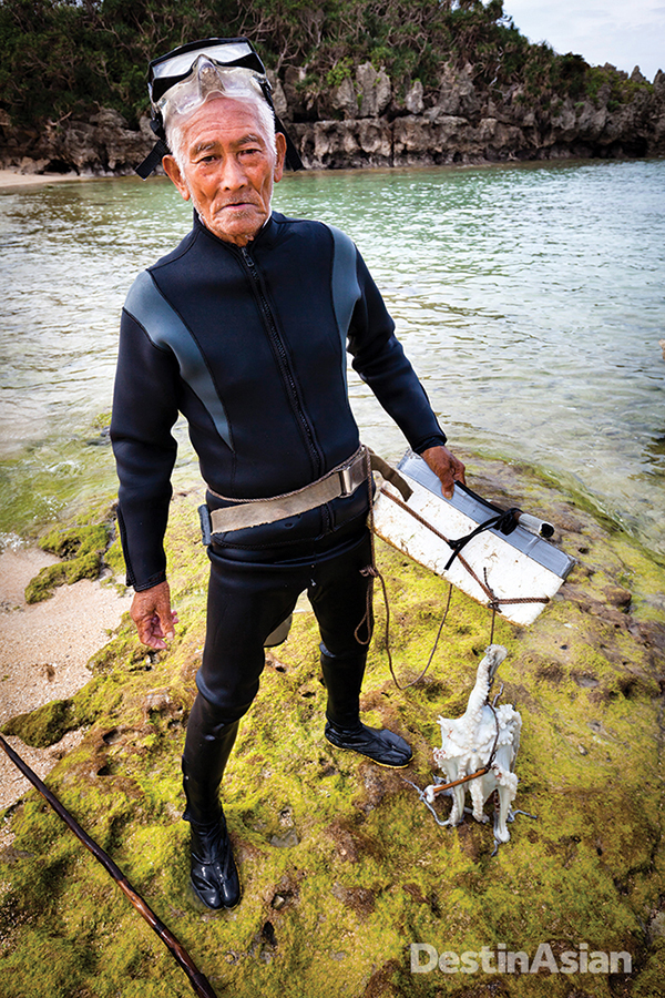 An 82-year-old (and still active) Okinawan fisherman with a fresh-caught octopus.