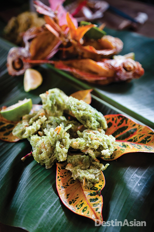 Okinawan delicacies are served on a banana leaf at the Inutabu village restaurant.