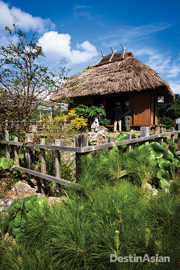 The communal restaurant of Inutabu village occupies a traditional thatched-roof building with sweeping views of cane fields and the ocean beyond.