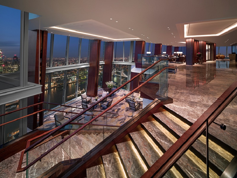 The lobby rests in the city's heights, as the hotel occupies floors 34-52.