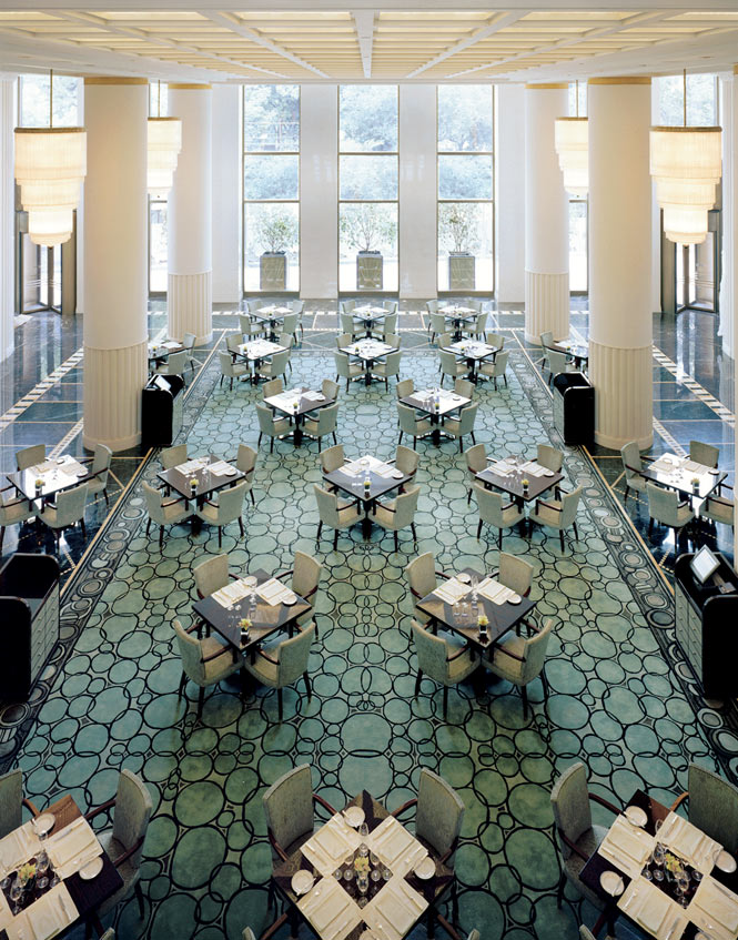 Tables set for afternoon tea in the soaring lobby.