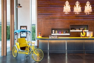 The hotel's lobby features Bangkok-inspired design details, such as the tuk-tuk pictured.