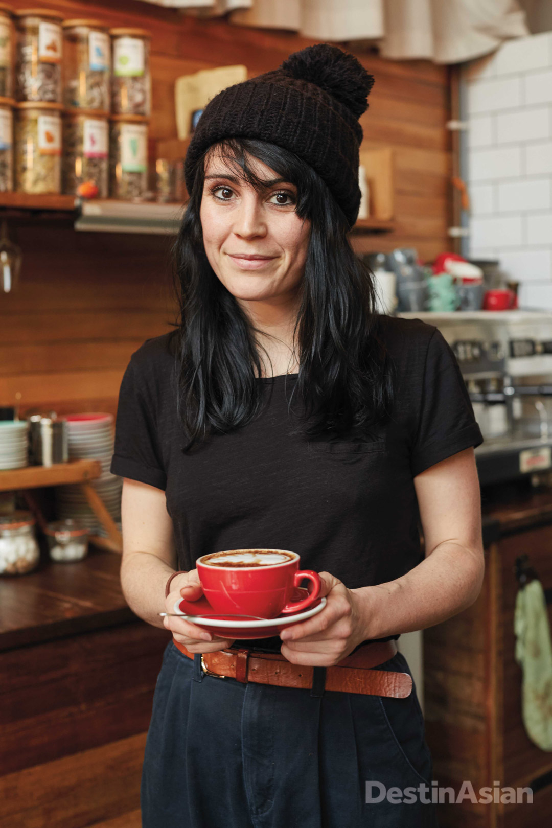 A barista at café and bar Barge House.