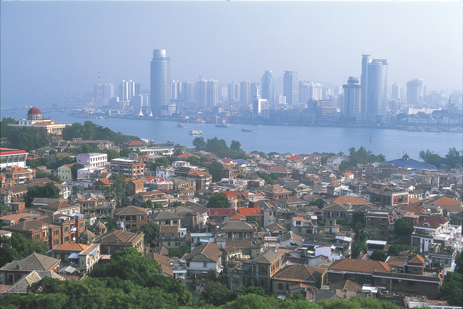 Looking east across the old rooftops of Gulangyu to high-rise Xiamen