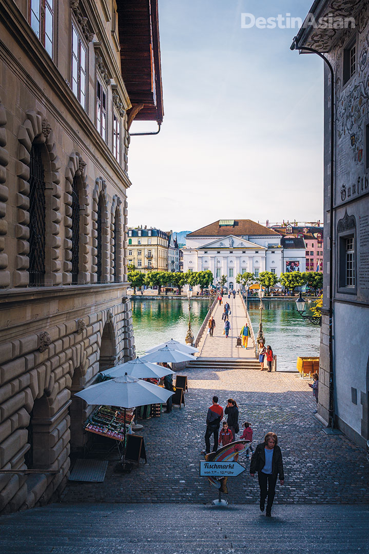 "A cobbled passage beside Lucerne's old 17th-century town hall leads down to the Reuss River and the Neustadt (""new city"") area beyond. All photos by Lola Akinmade Åkerström."