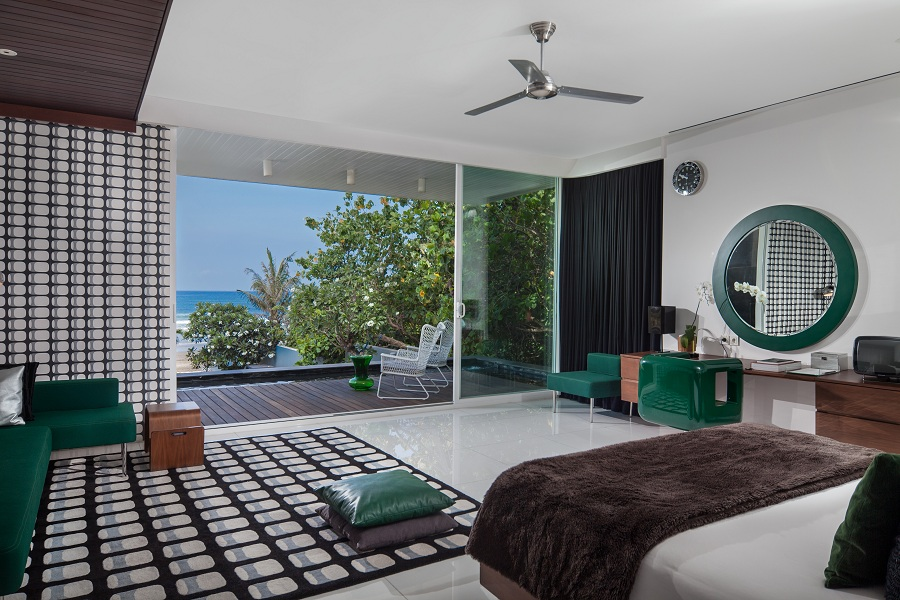 The master bedroom overlooks a roof terrace and the ocean.