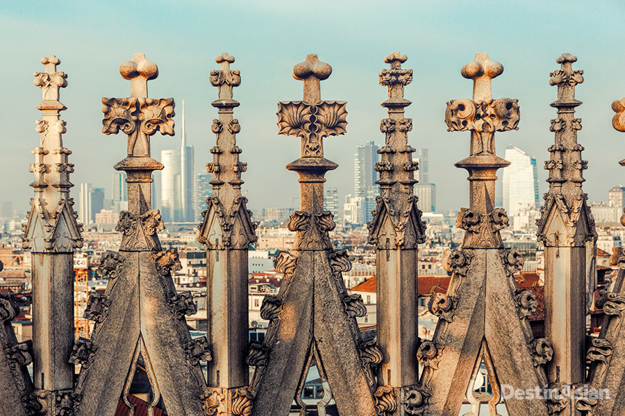 City views through the fretted spires of the Duomo's rooftop terraces.