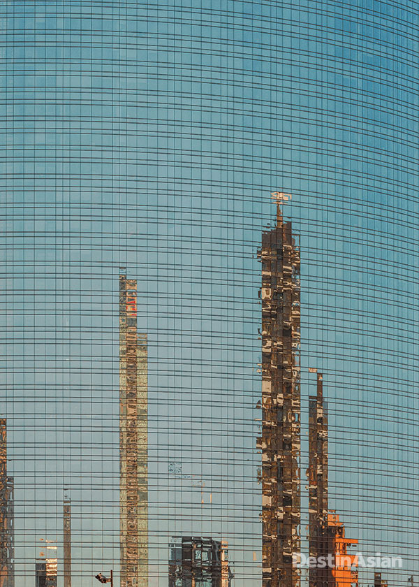 A new glass office tower in downtown Milan reflects the city's changing skyline.