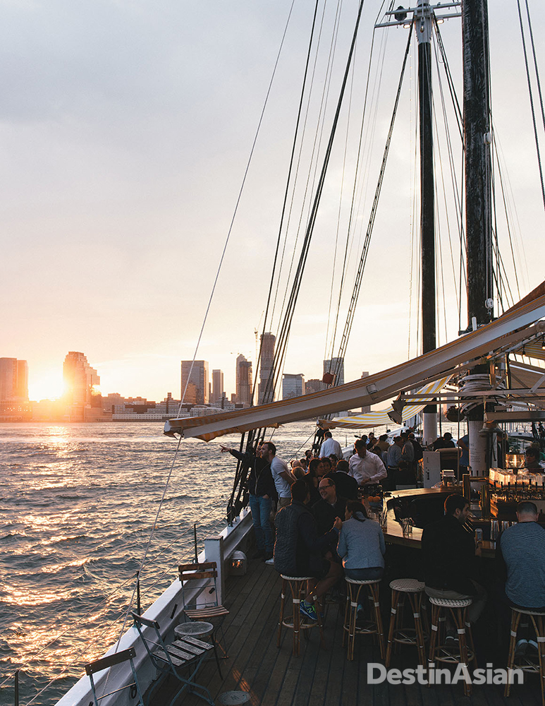 A view of the setting sun from Grand Banks, a seasonal oyster bar on a historic codfish schooner docked off Hudson River Park in TriBeCa.