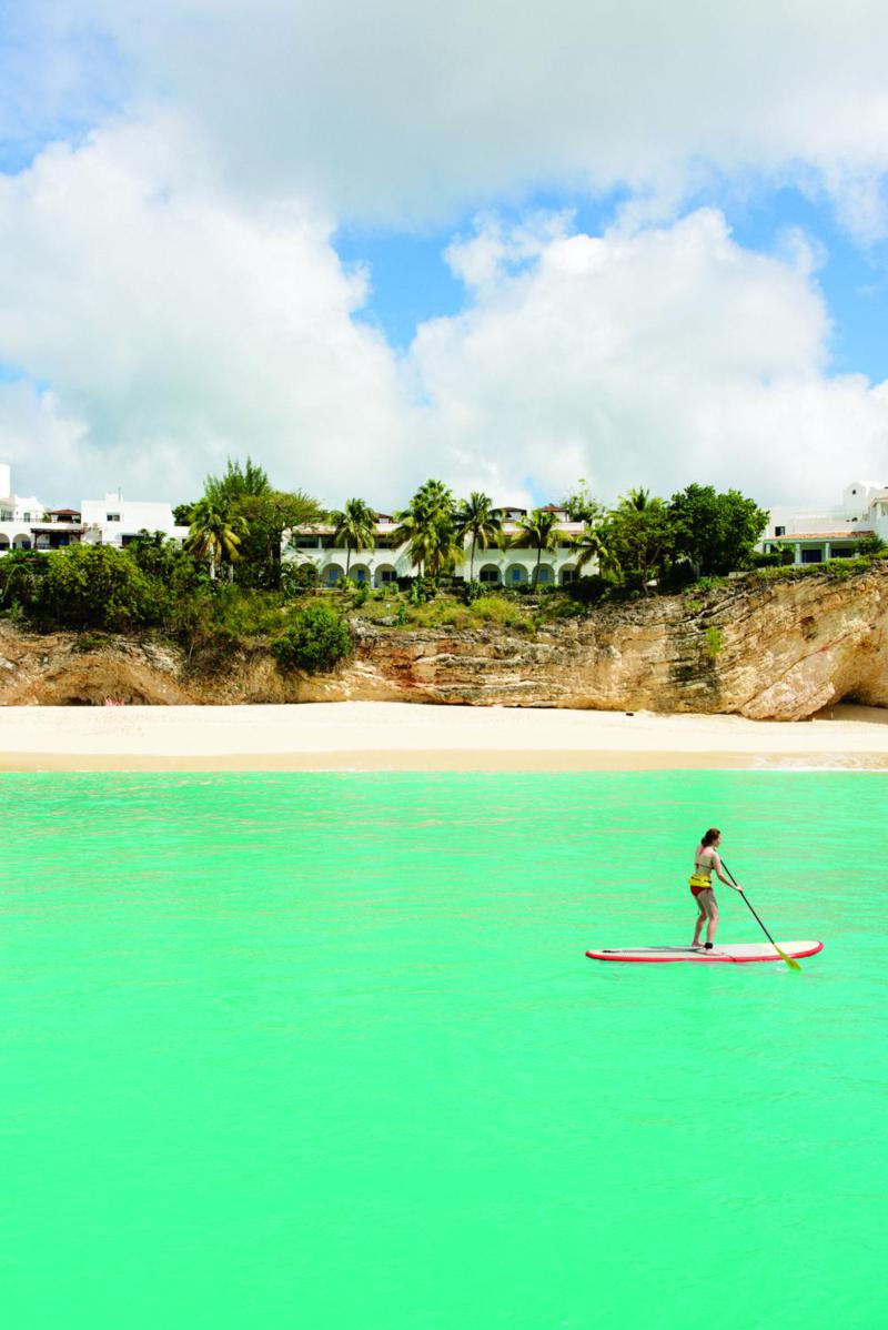 Paddling past the powdery white sand of Baie Longue, one of St. Martin's longest beaches.