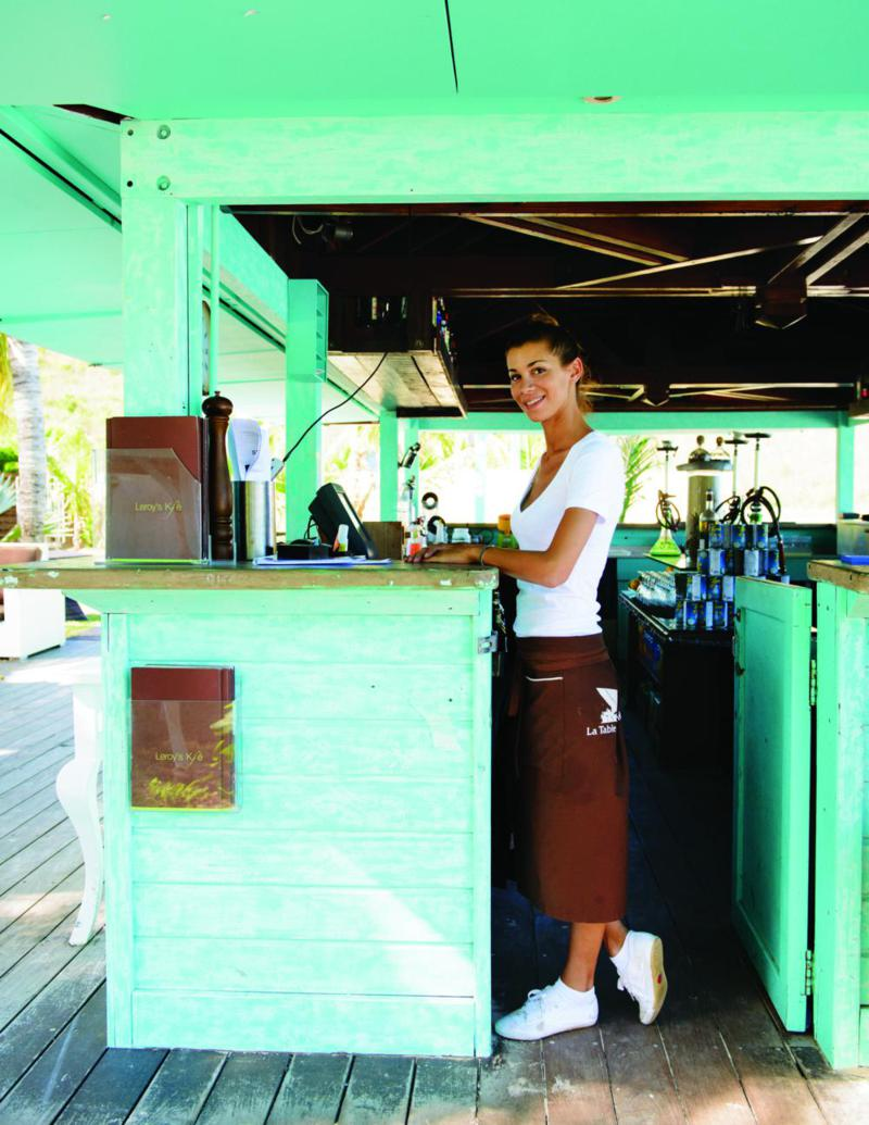 Service with a smile at an Anse Marcel café.