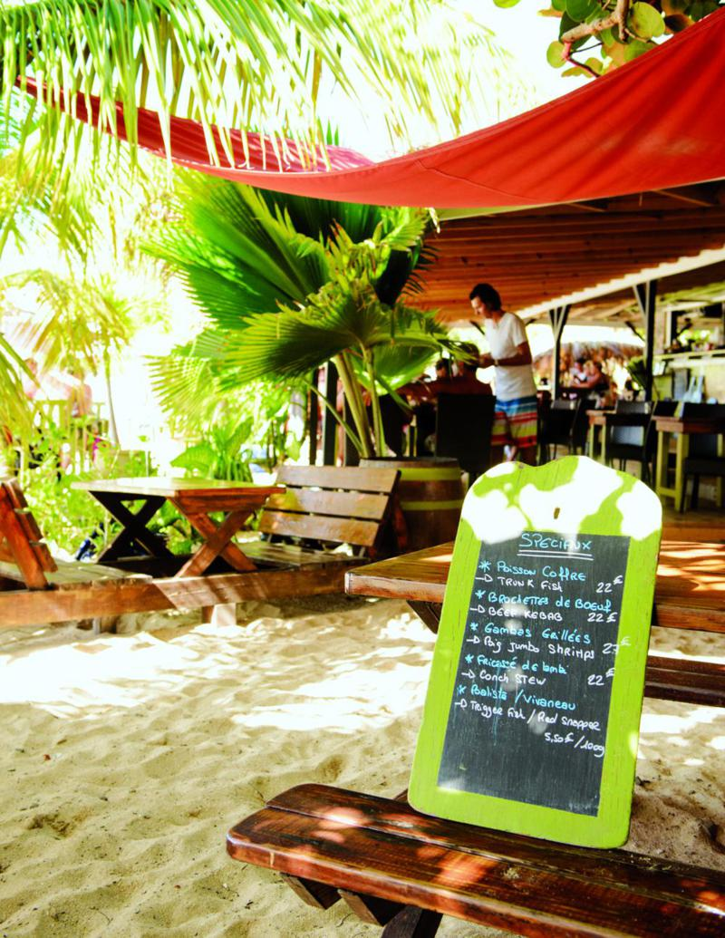 Lunchtime at the beachside Karibuni restaurant on Ilet Pinel, the perfect place to laze a day away.