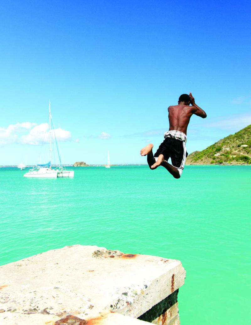 The warm azure waters that encircle St. Martin are irresistible, even to locals.