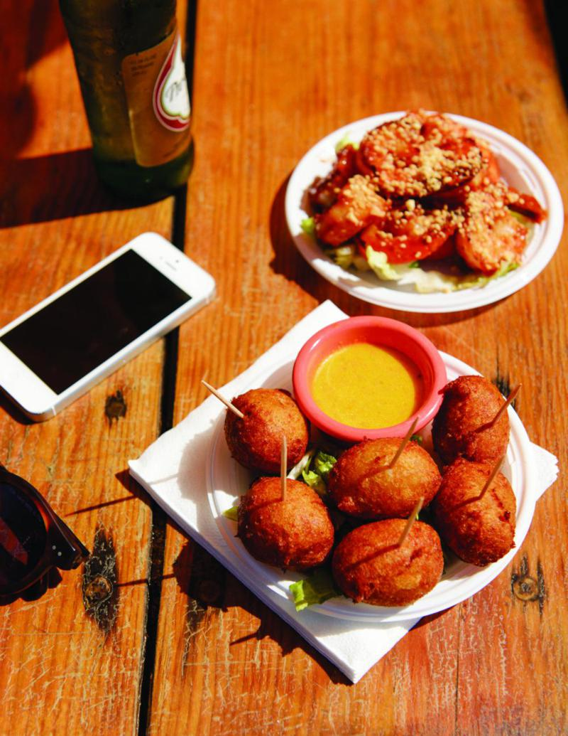 A quintessential Caribbean snack of fish fritters and shrimp.