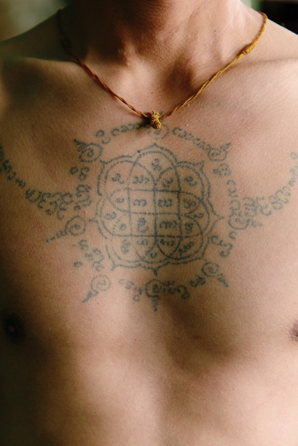 A local guide shows off his Buddhist tattoo.