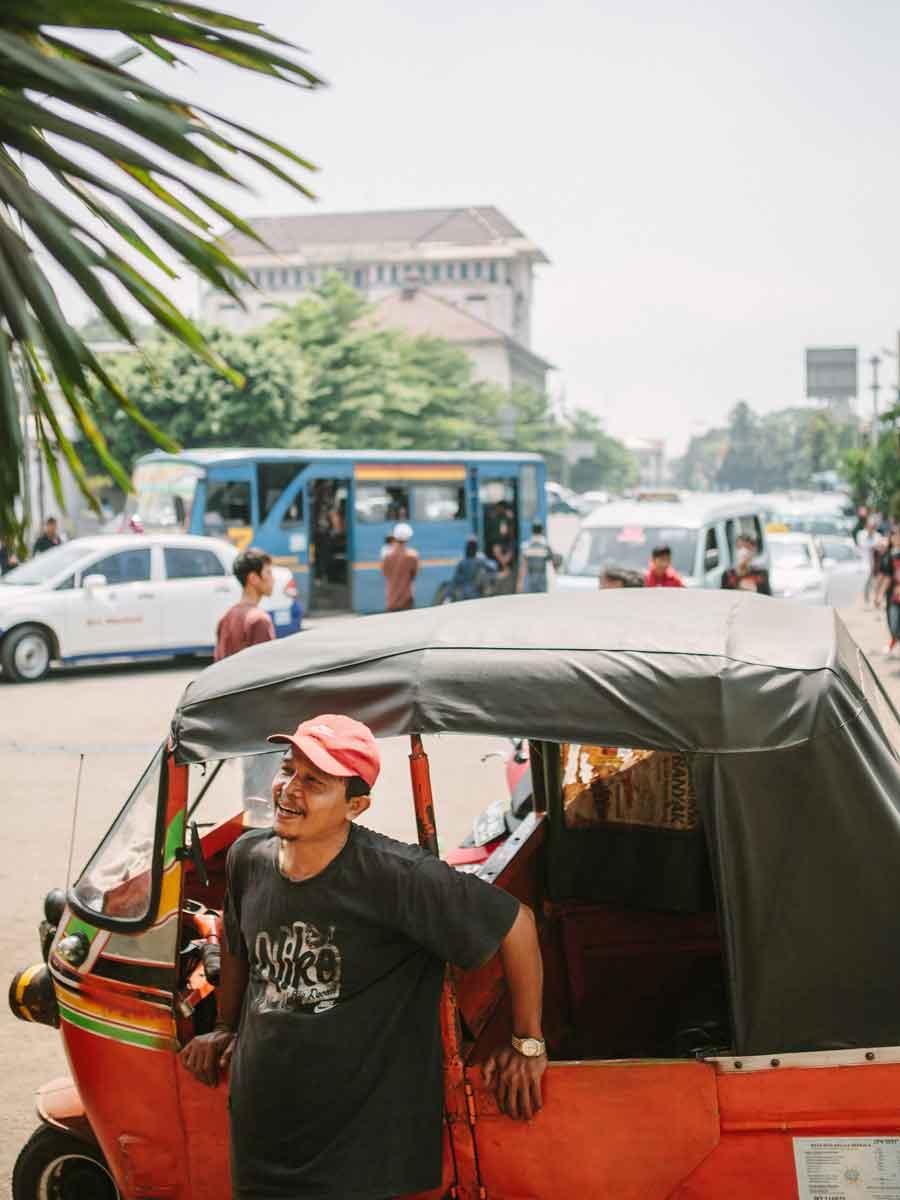 Jakarta's ubiquitous three-wheeled  bajaj taxi and driver.