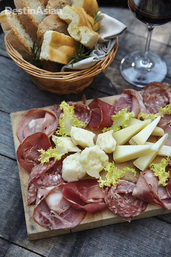 A platter of salumi and cheese accompanies tasting sessions at L'Andana's winery.