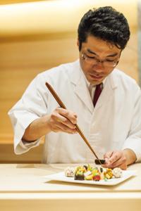 Sushi master Hiroki Sudou at work.