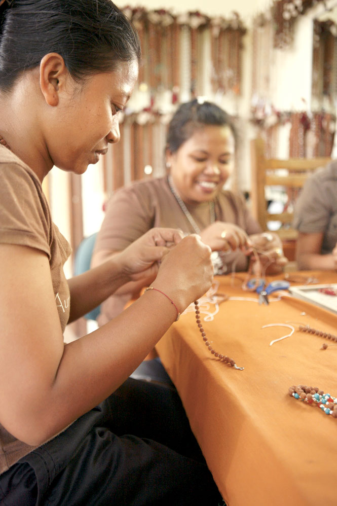 Workers at Soma Temple's Bali bungalow fashion simple bracelets.