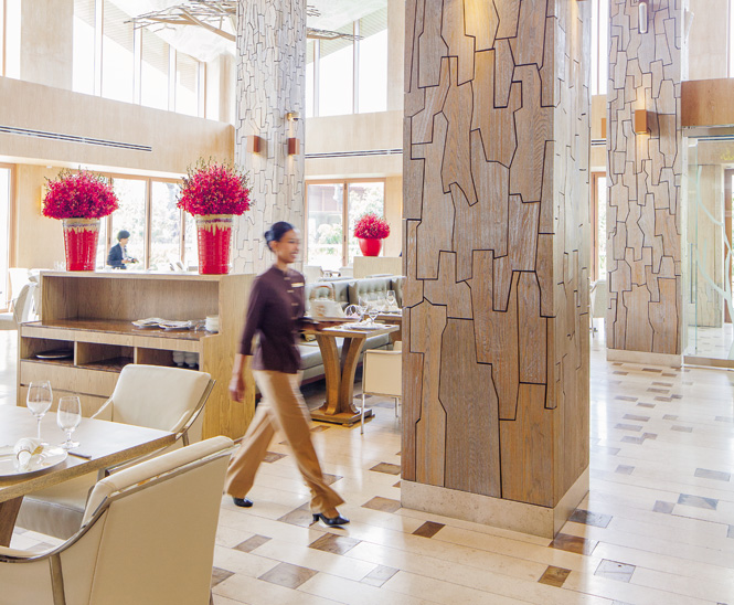 Trunk-like columns rise above the dining room at Forest.