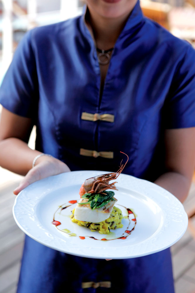 The Orion II's gourmet cuisine includes dishes such as this black-cod fillet with saffron risotto, wild rice, and Australian crayfish.