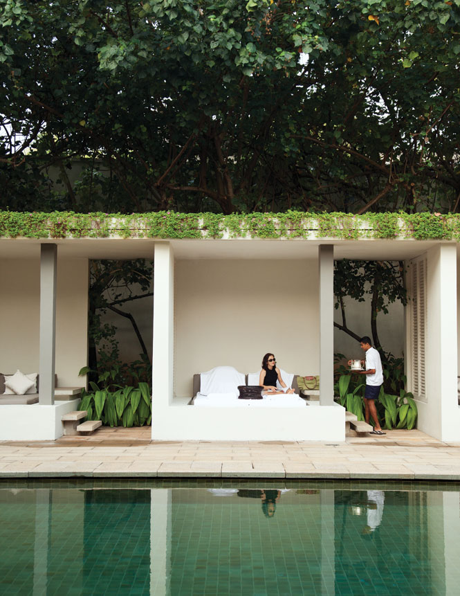 Poolside at the Amangalla, which breathed luxurious new life into the former New Oriental Hotel when it opened in 2005.