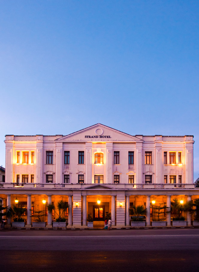 The Neoclassical facade of The Strand, a landmark 1901 hotel in the heart of Yangon.