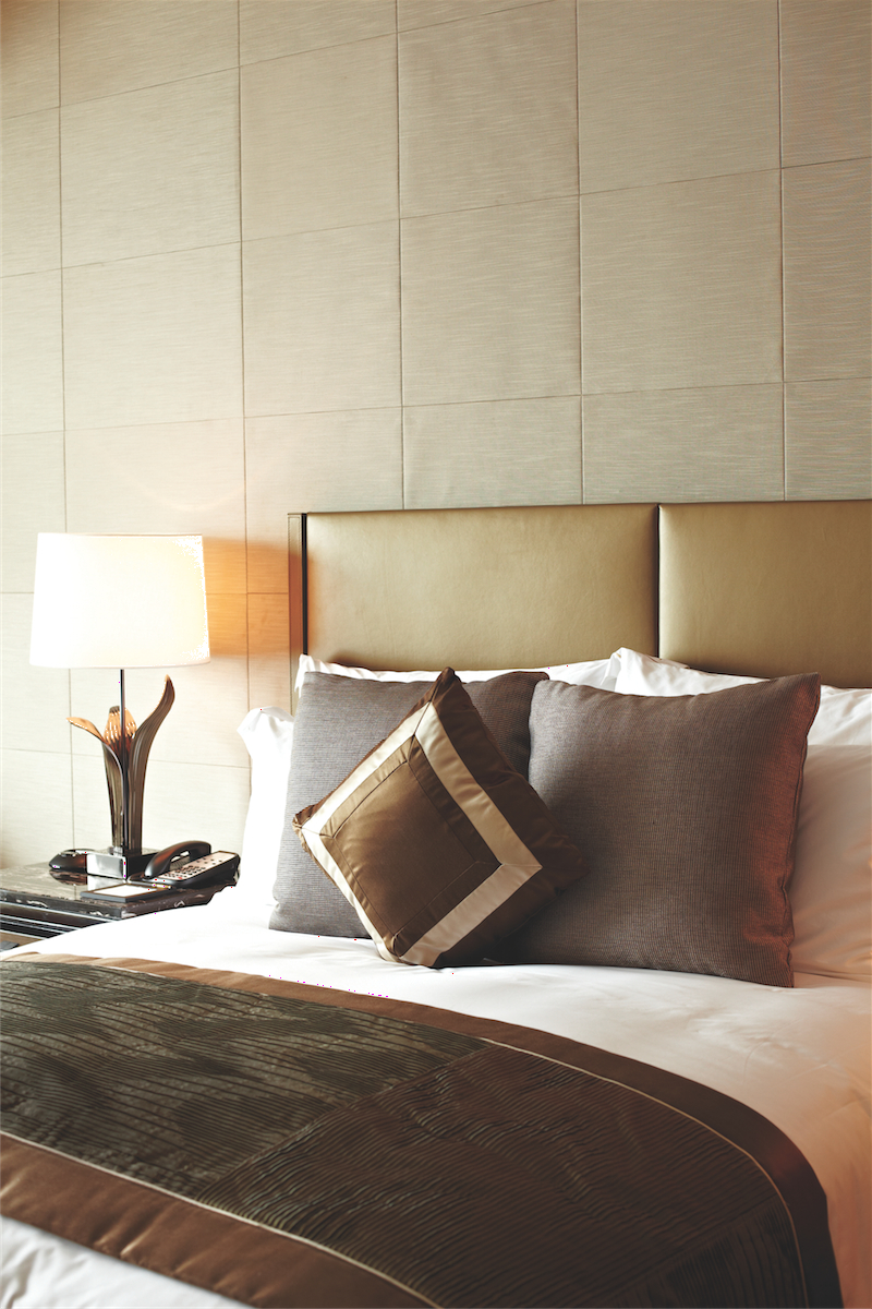Details such as a leather headboard and goose-down duvet add to the plush comforts of a room on the 109th floor.