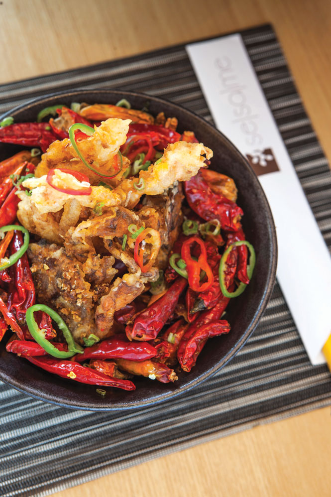 Se Sa Me's signature Dragon's Breath is a Sichuan-inspired bowl of dried red chilies served with a choice of ingredients, from soft-shell crab to lamb chops.