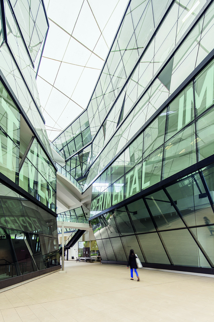 The soaring central atrium at LaSalle College of the Arts, which comprises six faceted, organically shaped buildings.