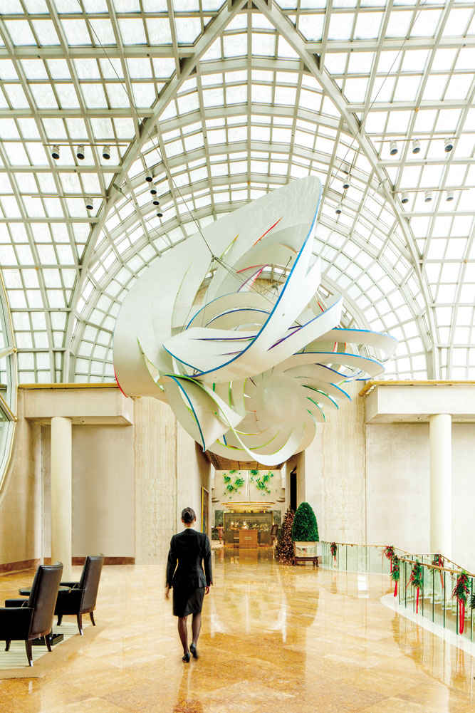 Cornucopia, a fiberglass sculpture by Frank Stella, hangs above the Ritz- Carlton, Millenia Singapore's lobby