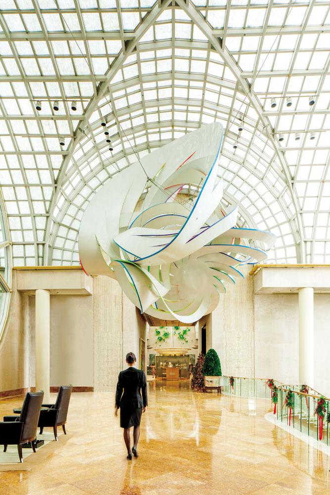 Cornucopia, a fiberglass sculpture by Frank Stella, hangs above the Ritz- Carlton, Millenia Singapore's lobby