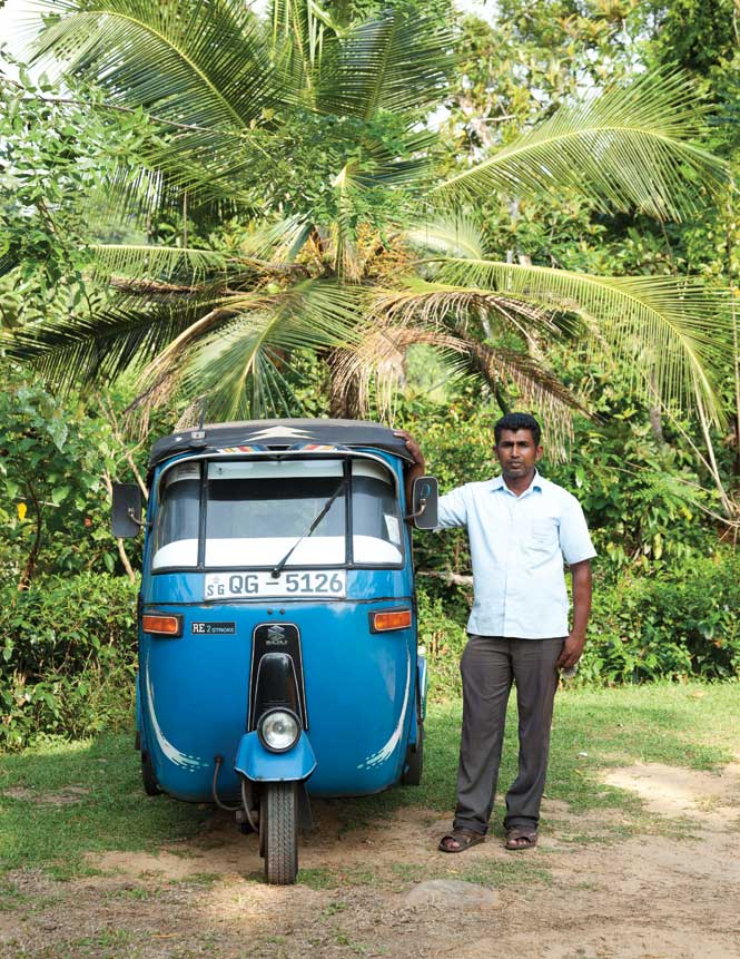 A tuk-tuk driver waiting for a fare in Galle.