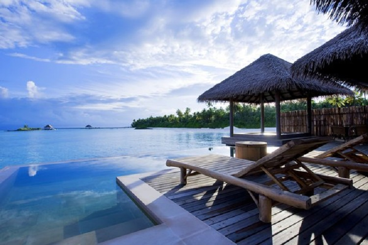 Accommodations include 13 water villas with private pools, as seen above.