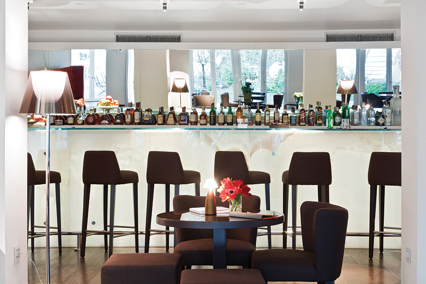 Behind a secret door, Magna Pars Suites in Milan has a hidden lounge where trendsetters gather at the white onyx bar.