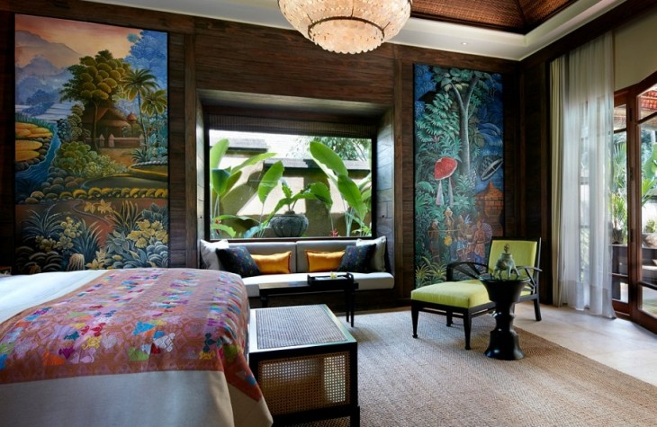 The one bedroom pool villa at Mandapa, adorned with paintings on the wall and colorful accents.