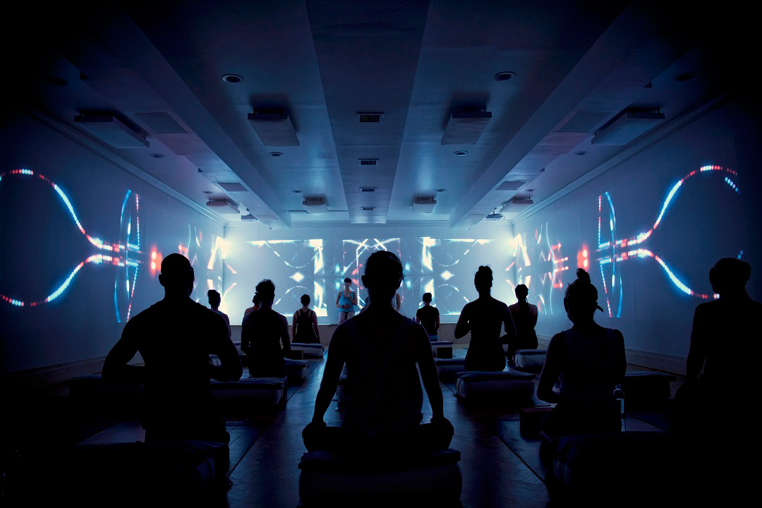 An immersive meditation session at Woom Center.