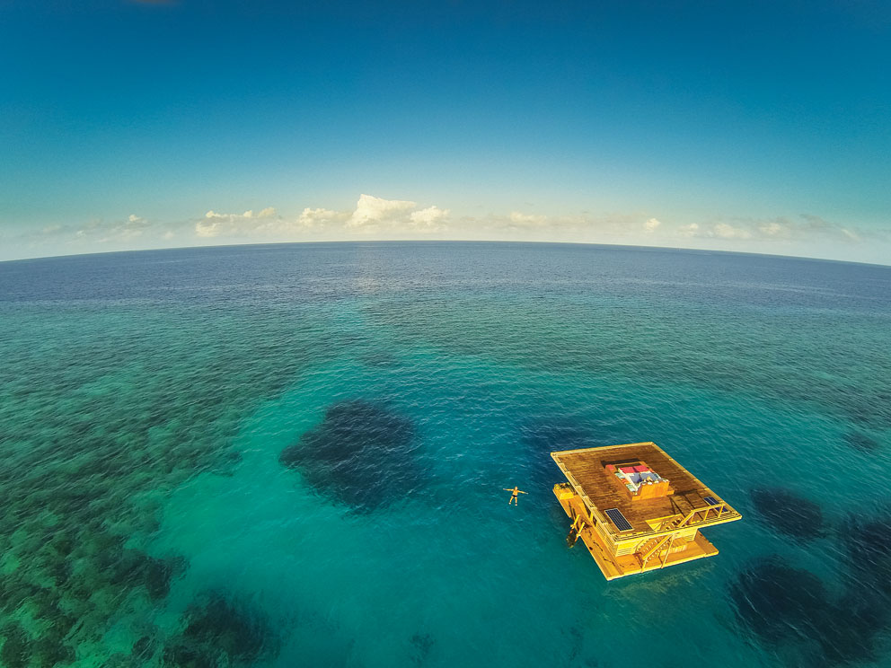 The Manta Resort's Underwater Suite has an above water deck and living room and a submerged bedroom with ocean views.