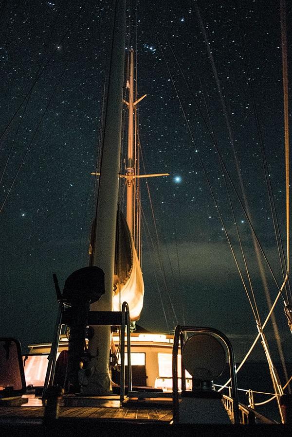 At anchor under a star-studded sky.
