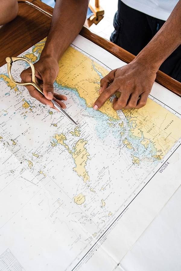 Captain Ekachai Pongpaew charting a course through the islands.