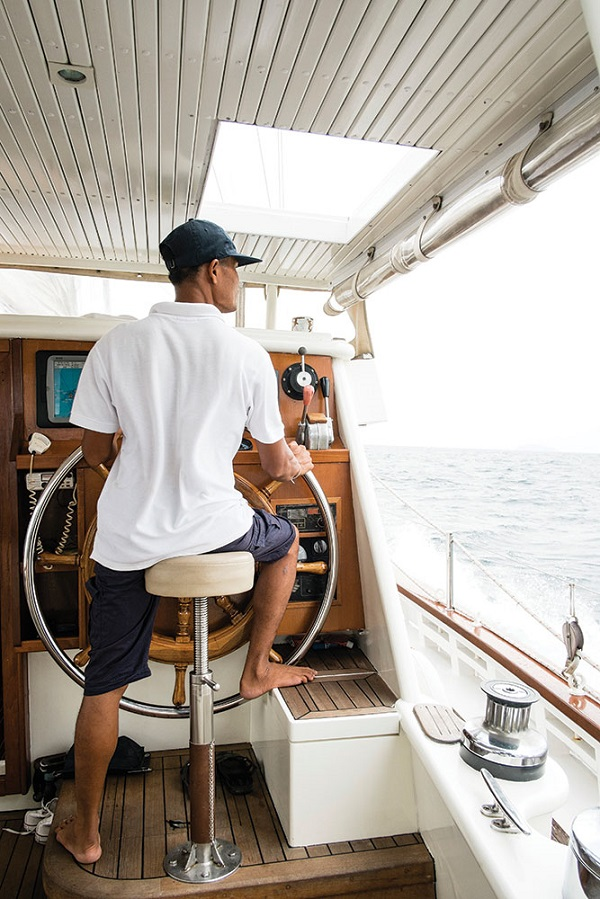 The first mate at the wheel.