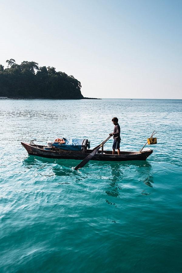 A Moken sea gypsy in his dugout canoe.